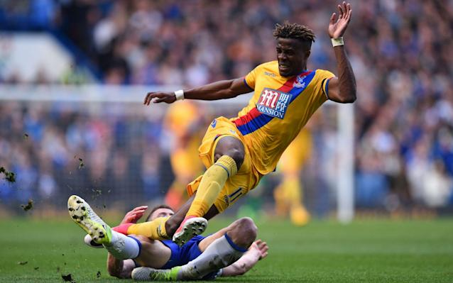 <span>Zaha drew a yellow card from Gary Cahill</span> <span>Credit: Getty images </span>