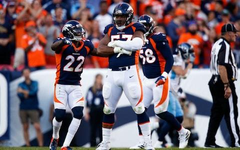 Denver Broncos defensive end DeMarcus Walker (57) celebrates with defensive back Kareem Jackson (22) after a play in the fourth quarter against the Tennessee Titans at Empower Field at Mile High - Credit: USA Today