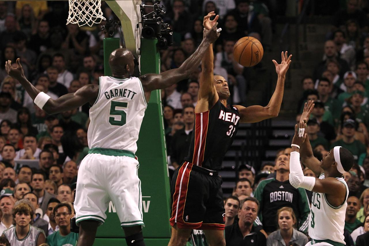 BOSTON, MA - JUNE 03:  Shane Battier #31 of the Miami Heat attempts to control a rebound against Kevin Garnett #5 and Rajon Rondo #9 of the Boston Celtics in Game Four of the Eastern Conference Finals in the 2012 NBA Playoffs on June 3, 2012 at TD Garden in Boston, Massachusetts. NOTE TO USER: User expressly acknowledges and agrees that, by downloading and or using this photograph, User is consenting to the terms and conditions of the Getty Images License Agreement.  (Photo by Jim Rogash/Getty Images)