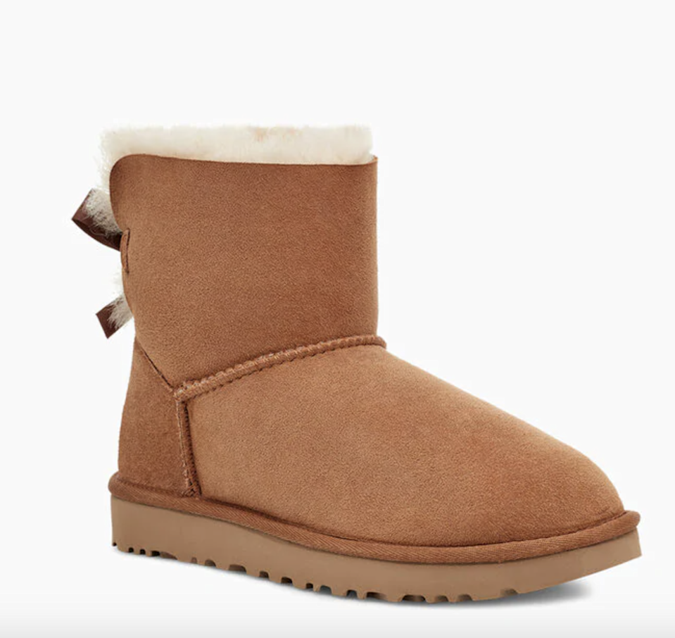 """<h2>Ugg Mini Bailey Boot</h2><br>Ah, yes. Wearing these with cozy sweats and a <a href=""""https://www.hollisterco.com/shop/us/p/applique-logo-hoodie-40640320"""" rel=""""nofollow noopener"""" target=""""_blank"""" data-ylk=""""slk:Hollister hoodie"""" class=""""link rapid-noclick-resp"""">Hollister hoodie</a> was the epitome of middle school, and we miss it. <br><br><strong>Ugg</strong> Ugg Mini Bailey Boot, $, available at <a href=""""https://go.skimresources.com/?id=30283X879131&url=https%3A%2F%2Fwww.ugg.com%2Fclassics%2Fmini-bailey-bow-ii-boot%2F1016501.html"""" rel=""""nofollow noopener"""" target=""""_blank"""" data-ylk=""""slk:Ugg"""" class=""""link rapid-noclick-resp"""">Ugg</a>"""
