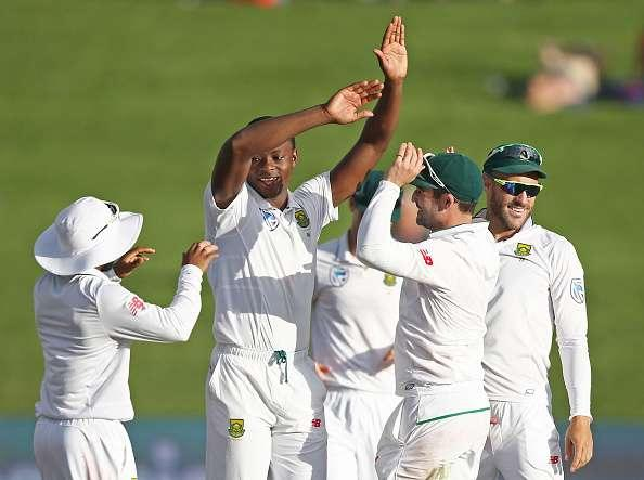 HAMILTON, NEW ZEALAND - MARCH 27: Kagiso Rabada of South Africa is congratulated on taking the wicket of Henry Nicholls of New Zealand during day three of the Test match between New Zealand and South Africa at Seddon Park on March 27, 2017 in Hamilton, New Zealand. (Photo by Dave Rowland/Getty Images)