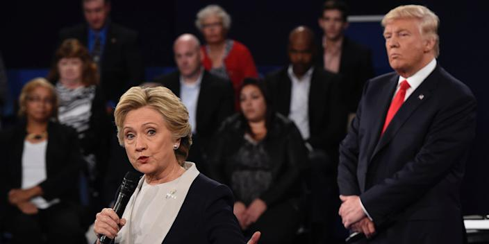 "Republican nominee Donald Trump (R) watches Democratic nominee Hillary Clinton during the second presidential debate on October 9, 2016 <p class=""copyright"">Saul Loeb/AFP via Getty Images</p>"
