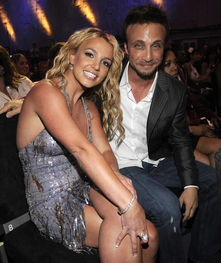 LOS ANGELES, CA - SEPTEMBER 07:  Britney Spears and Larry Rudolph in the audience at the 2008 MTV Video Music Awards at Paramount Pictures Studios on September 7, 2008 in Los Angeles, California.  (Photo by Kevin Mazur/WireImage)