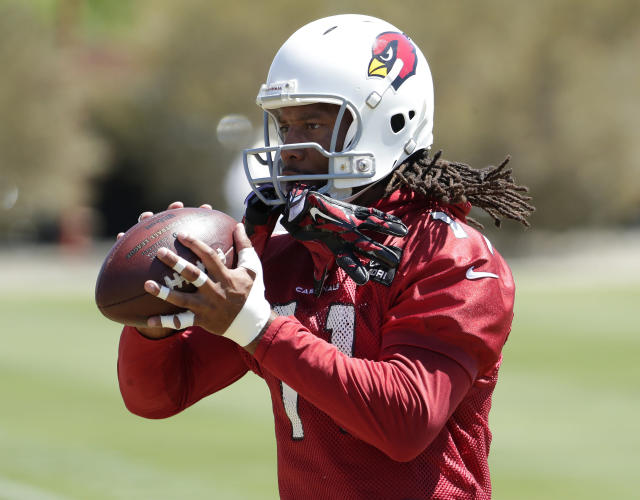 Arizona Cardinals' Larry Fitzgerald makes a catch during practice at the NFL football team's training camp, Tuesday, June 12, 2018, in Tempe, Ariz. (AP Photo/Matt York)