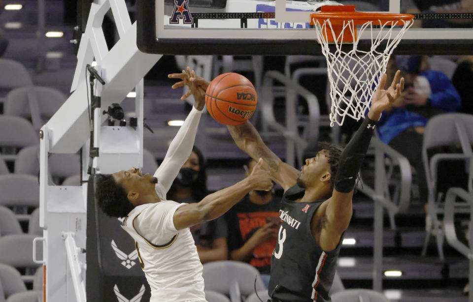 Wichita State guard Alterique Gilbert (3) and Cincinnati forward Tari Eason (13) collide under the basket during the first half of an NCAA college basketball game in the semifinal round of the American Athletic Conference men's tournament Saturday, March 13, 2021, in Fort Worth, Texas. (AP Photo/Ron Jenkins)