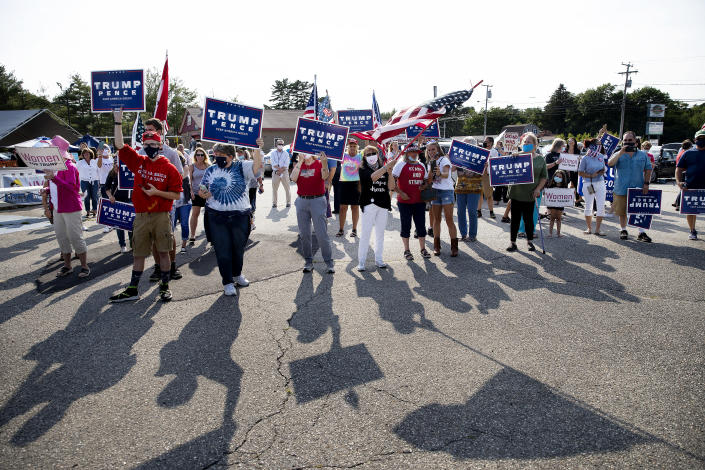 Trump supporters wait for Lara Trump at Jimmy the Greeks restaurant in Old Orchard Beach on Wednesday, July 22, 2020, during a stop on the Women for Trump bus tour. (Derek Davis/Portland Press Herald via Getty Images)