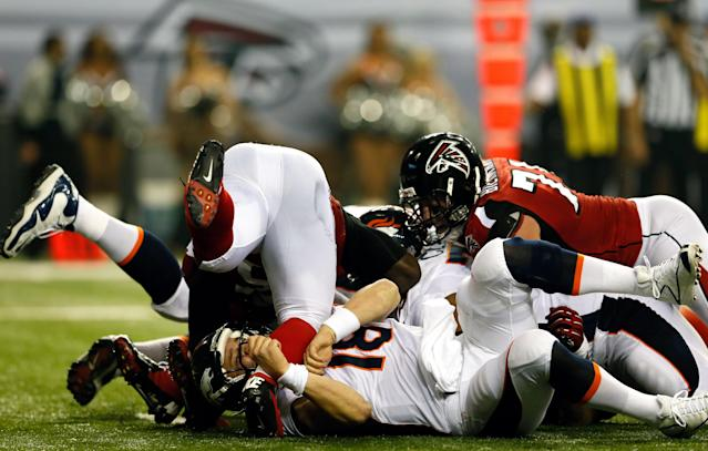 ATLANTA, GA - SEPTEMBER 17: Quarterback Peyton Manning #18 of the Denver Broncos is tackled by the Atlanta Falcons during a game at the Georgia Dome on September 17, 2012 in Atlanta, Georgia. (Photo by Kevin C. Cox/Getty Images)