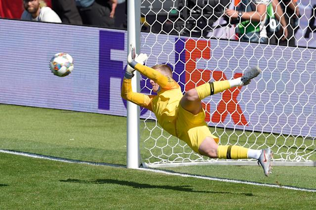 Pickford saves the decisive penalty against Switzerland (Photo by Octavio Passos - UEFA/UEFA via Getty Images)