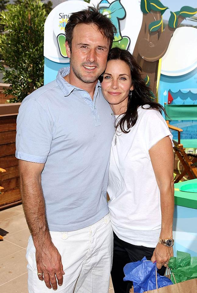 """David Arquette hugs wife, Courteney, at the EB Medical Research Foundation picnic in Malibu. The former """"Friends"""" star hosted the benefit. Jason Merritt/<a href=""""http://www.gettyimages.com/"""" target=""""new"""">GettyImages.com</a> - June 28, 2009"""