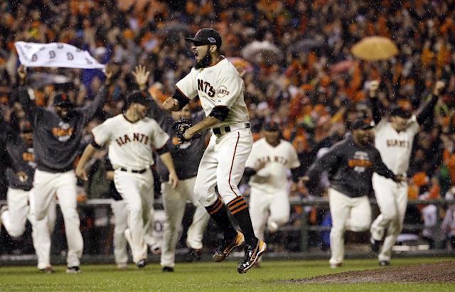 San Francisco Giants relief pitcher Sergio Romo reacts after the final out in Game 7 of baseball's National League championship series against the St. Louis Cardinals Monday, Oct. 22, 2012, in San Francisco. The Giants won 9-0 to win the series. (AP Photo/David J. Phillip)