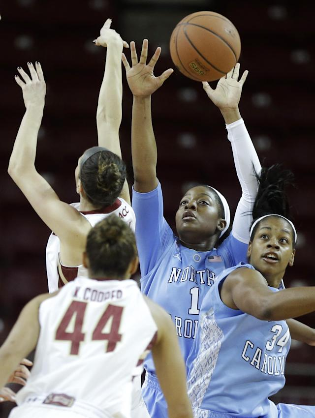 North Carolina forward Stephanie Mavunga (1) and forward Xylina McDaniel (34) vie for control of the ball with Boston College guard Kat Cooper (44) in the first half of an NCAA college basketball game on Sunday, Jan. 19, 2014, in Boston. (AP Photo/Steven Senne)