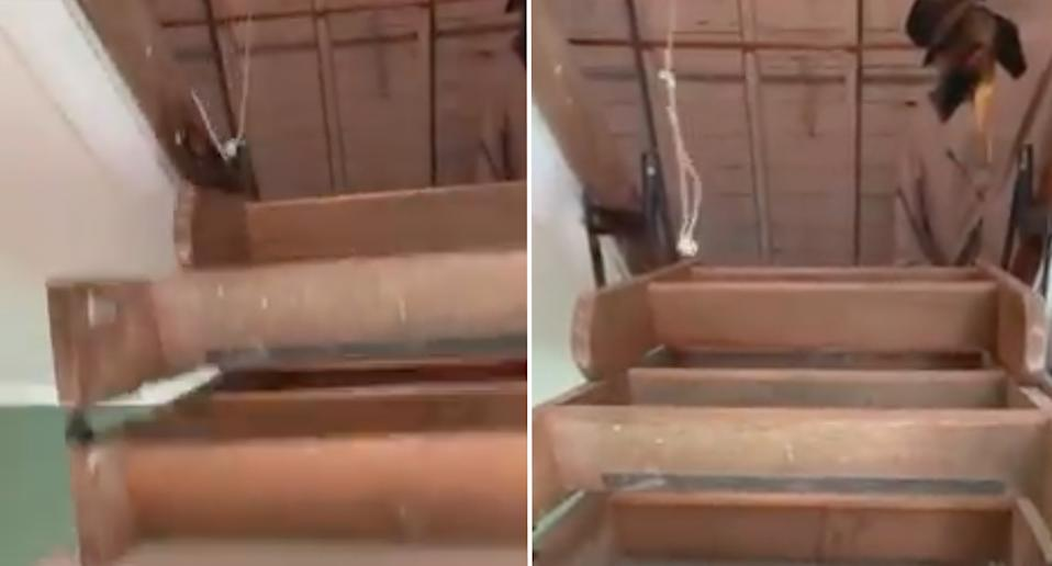 The mannequin can be seen sitting at the top of the attic stairs.