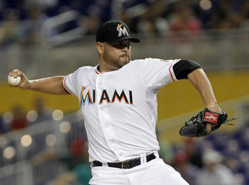 Miami Marlins' Ricky Nolasco delivers a pitch during the first inning of a baseball game against the Washington Nationals, Tuesday, Aug. 28, 2012, in Miami. (AP Photo/Wilfredo Lee)