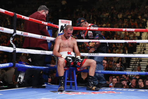 Sergey Kovalev sits in his corner between rounds against Canelo Alvarez during a light heavyweight WBO title bout, Saturday, Nov. 2, 2019, in Las Vegas (AP Photo/John Locher)