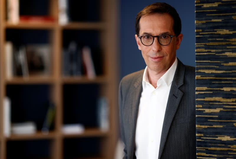 L'Oreal CEO Hieronimus poses after an interview with Reuters