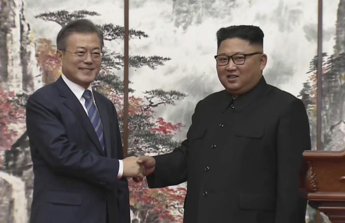 Kim Jong-Un with South Korean president Moon Jae-in (AP)