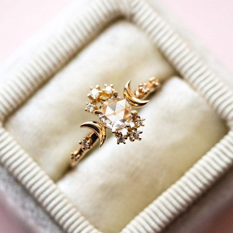 """<p>The <a href=""""https://www.popsugar.com/buy/Rosecut-Diamond-Wandering-Star-Ring-532226?p_name=Rosecut%20Diamond%20Wandering%20Star%20Ring&retailer=localeclectic.com&pid=532226&price=2%2C708&evar1=fab%3Aus&evar9=7954958&evar98=https%3A%2F%2Fwww.popsugar.com%2Fphoto-gallery%2F7954958%2Fimage%2F47021274%2FRosecut-Diamond-Wandering-Star-Ring&list1=shopping%2Cwedding%2Cjewelry%2Crings%2Cbride%2Cengagement%20rings%2Cfashion%20shopping&prop13=api&pdata=1"""" rel=""""nofollow noopener"""" class=""""link rapid-noclick-resp"""" target=""""_blank"""" data-ylk=""""slk:Rosecut Diamond Wandering Star Ring"""">Rosecut Diamond Wandering Star Ring</a> ($2,708) is inspired by a line in an E.E. Cumings poem """"you are my sun, my moon, and all my stars . . . """" and with its gold carved crescent moons, we can see it. </p>"""