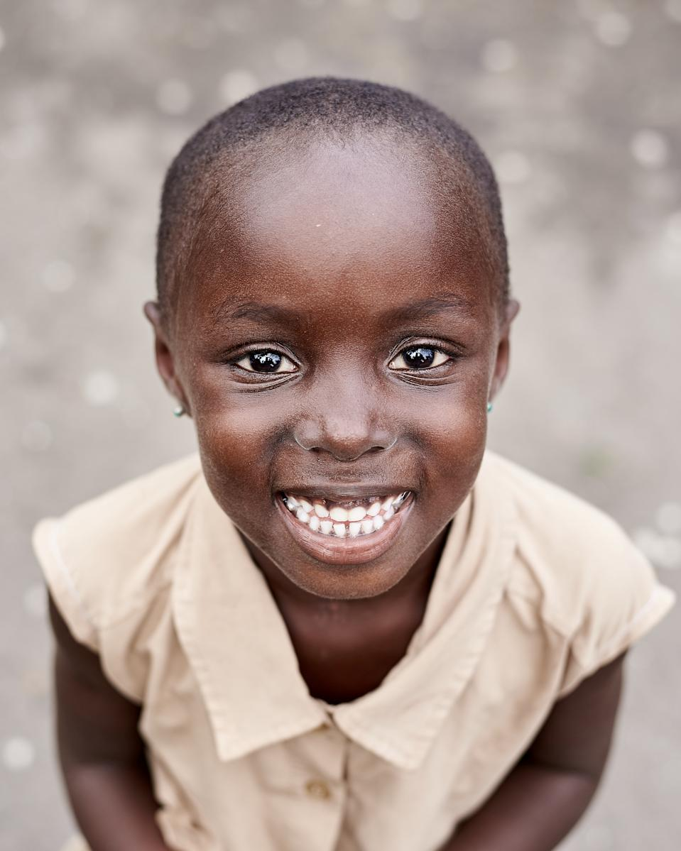@tarimobowei perfectly portrayed the happiness and joy in this little girl's eyes in Ghana. [Photo: SWNS]