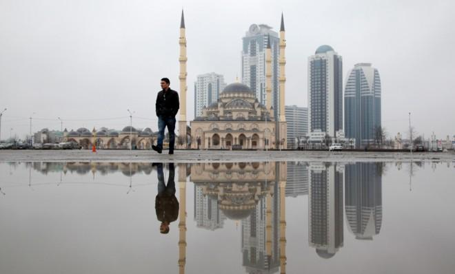 A man walks in downtown Grozny, Chechnya's capital, on Feb. 26, 2013.