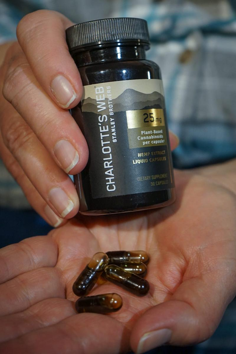 Jeanette Hales holds the CBD tablets she was taking. She has stopped using the product after the positive test results.