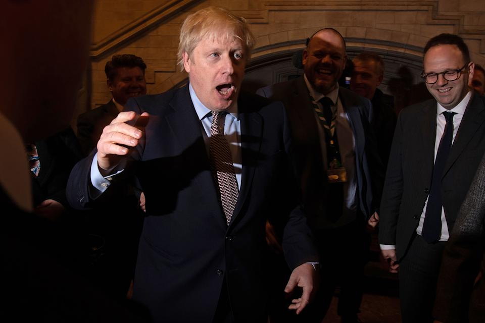 Britain's Prime Minister Boris Johnson greets newly-elected Conservative MPs in Westminster Hall in the Palace of Westminster, central London on December 16, 2019. Photo: LEON NEAL/POOL/AFP via Getty Images