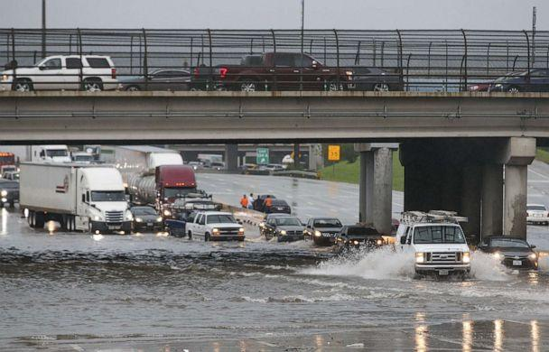 PHOTO: Cars pull to the side of the freeway of highway 69 North to get by the flood waters on September 19, 2019 in Houston, Texas. (Thomas B. Shea/Getty Images)
