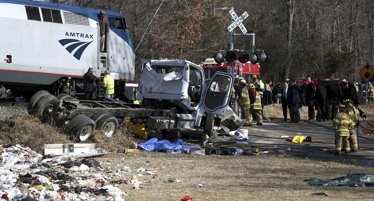 Emergency personnel work at the scene of a train crash involving a garbage truck in Crozet, Va., on Wednesday. (Zack Wajsgrasu/The Daily Progress via AP)