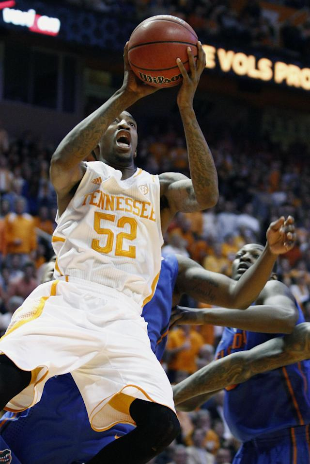 Tennessee guard Jordan McRae (52) shoots in the first half of an NCAA college basketball game against Florida, Tuesday, Feb. 11, 2014, in Knoxville, Tenn. (AP Photo/Wade Payne)