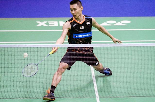 Malaysia's Lee Chong Wei hits a shot against China's Chen Long during the men's singles final at the Hong Kong Open badminton tournament in Hong Kong on November 26, 2017 (AFP Photo/ISAAC LAWRENCE)