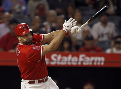 FILE - In this Monday, June 4, 2018 file photo, Los Angeles Angels' Albert Pujols hits an RBI single to score Mike Trout against the Kansas City Royals during the sixth inning of a baseball game in Anaheim, Calif. os Angeles Angels slugger Albert Pujols is likely to miss the rest of the season after undergoing surgery on his left knee. The Angels announced Pujols' arthroscopic knee surgery Wednesday, Aug. 29, 2018. (AP Photo/Alex Gallardo, File)
