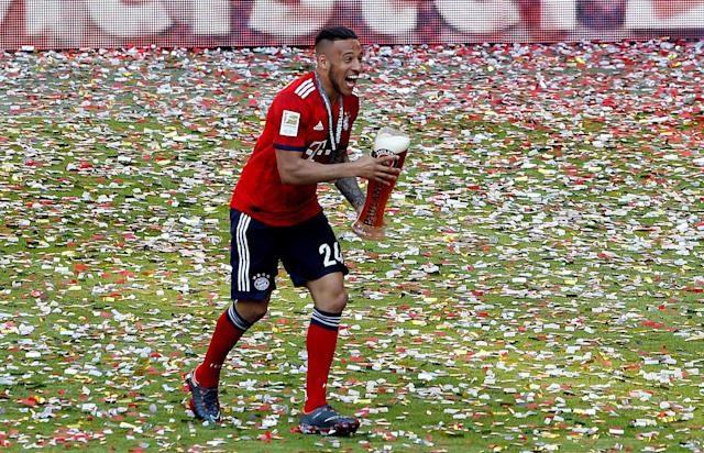 Soccer Football - Bundesliga - Bayern Munich v VfB Stuttgart - Allianz Arena, Munich, Germany - May 12, 2018 Bayern Munich's Corentin Tolisso celebrates winning the Bundesliga REUTERS/Michaela Rehle DFL RULES TO LIMIT THE ONLINE USAGE DURING MATCH TIME TO 15 PICTURES PER GAME. IMAGE SEQUENCES TO SIMULATE VIDEO IS NOT ALLOWED AT ANY TIME. FOR FURTHER QUERIES PLEASE CONTACT DFL DIRECTLY AT + 49 69 650050