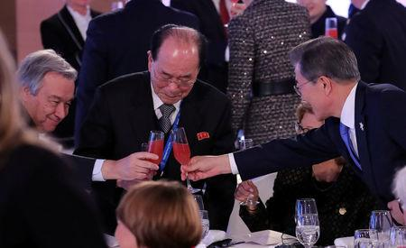 REFILE - FIXING APOSTROPHE South Korean President Moon Jae-in toasts with U.N. Secretary-General Antonio Guterres and North Korea's nominal head of state Kim Yong Nam at the Winter Olympic reception in Pyeongchang, South Korea February 9, 2018. Yonhap via REUTERS