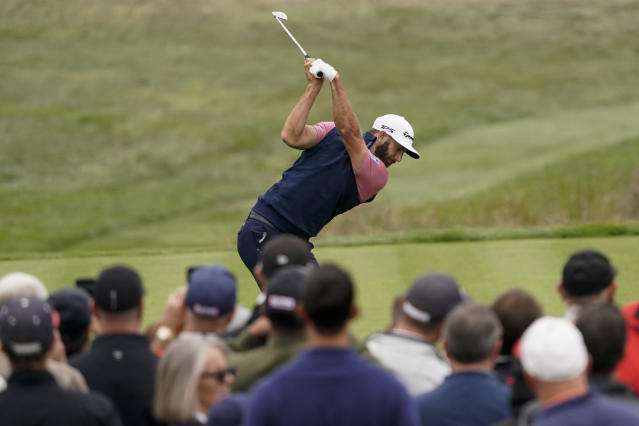 Dustin Johnson hits his tee shot on the fourth hole during the third round of the U.S. Open Championship golf tournament Saturday, June 15, 2019, in Pebble Beach, Calif. (AP Photo/David J. Phillip)