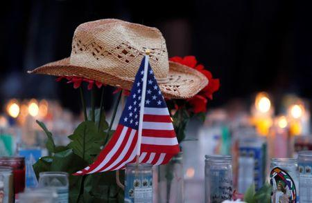A hat rests on flowers in a makeshift memorial during a vigil marking the one-week anniversary of the October 1 mass shooting in Las Vegas