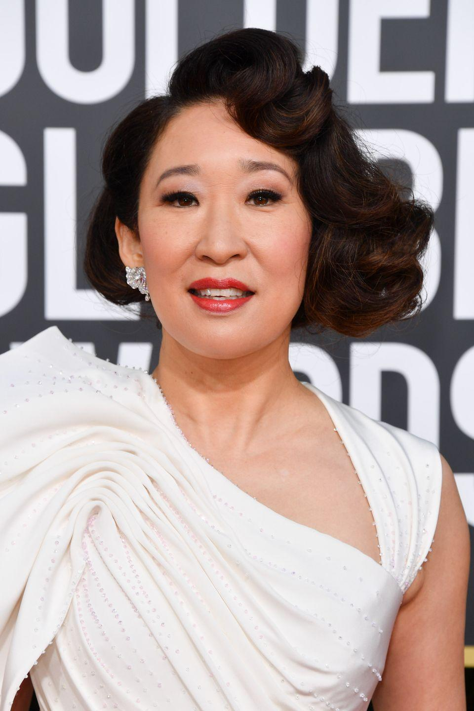 <p>Gorgeous inspiration for Asian hair types, actress <strong>Sandra Oh</strong> ups the glam factor of her asymmetrical bob with big, old Hollywood-esque waves. </p>