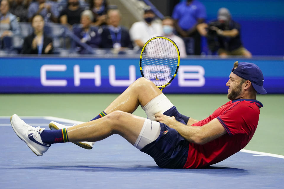 Jack Sock reacts to an injury during a match with Germany's Alexander Zverev during the third round of the US Open tennis championships, Saturday, Sept. 4, 2021, in New York. Zverev won the match after Sock withdrew with an injury. (AP Photo/Frank Franklin II)