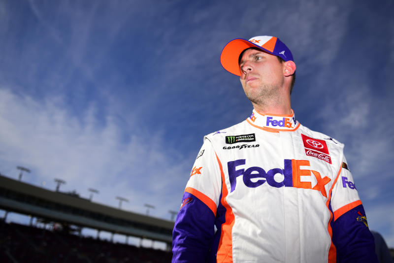 AVONDALE, ARIZONA - NOVEMBER 09: Denny Hamlin, driver of the #11 FedEx Ground Toyota, stands on the grid during qualifying for the Monster Energy NASCAR Cup Series Bluegreen Vacations 500 at ISM Raceway on November 09, 2019 in Avondale, Arizona. (Photo by Jared C. Tilton/Getty Images)