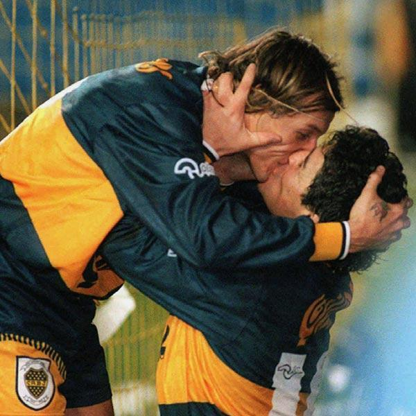 The super soccer kiss! After the notorious 'God's hand', this is second best act done by Argentine soccer star Diego Maradona. In this picture, Maradona, right, is seen kissing Claudio Caniggia after the latter scored Boca Juniors' second goal in their 4-1 match against archrival River Plate in 1996. After watching her husband's act, Caniggia's wife, ex-model Mariana Nannis, warned him that two can hug, but not kiss - especially on the lips.