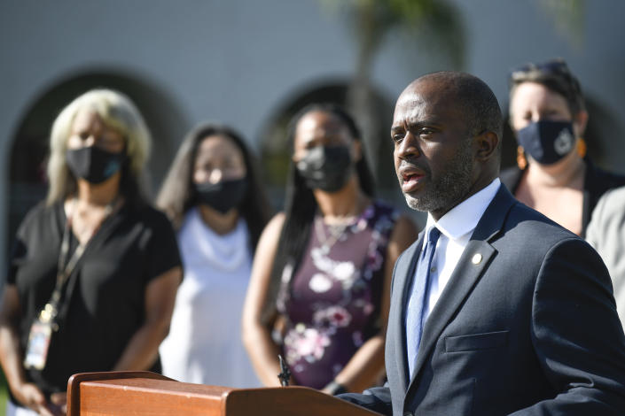 California State Superintendent of Public Instruction Tony Thurmond speaks outside of Enrique S. Camarena Elementary School on the first day of school, Wednesday, July 21, 2021, in Chula Vista, Calif. The school is among the first in the state to start the 2021-22 school year with full-day, in-person learning. (AP Photo/Denis Poroy)