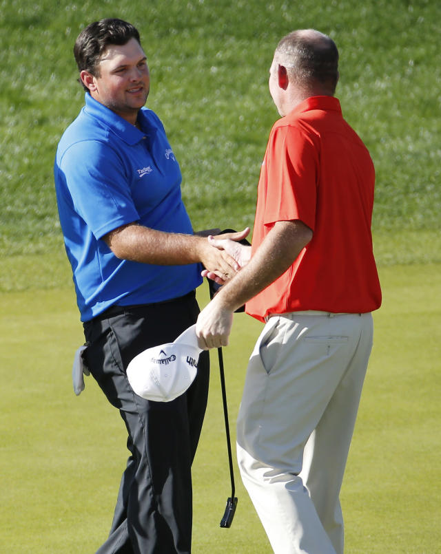 Patrick Reed, left, greets Tommy Gainey on the ninth tee after finishing their third round of the Humana Challenge PGA golf tournament on the Nicklaus Private course at PGA West, Saturday, Jan. 18, 2014, in La Quinta, Calif. Reed shot a 9-under par for the third day in a row and is 27-under par going into the final round. (AP Photo/Matt York)