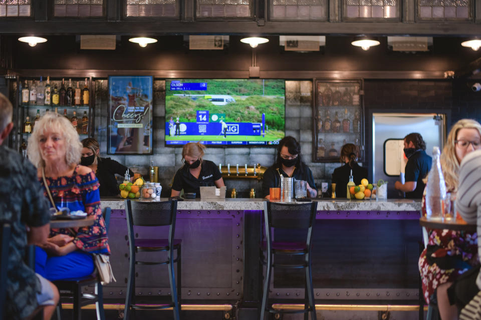 This photo provided by Adam M. Rammel shows The Syndicate bar on Aug. 20, 2020 in Bellefontaine, Ohio. Ohio's restrictions forced Adam Rammel to at least temporarily abandon plans for a catering and event space designed for parties and that opened last month, in time for the holidays. Rather than have the space sit unused, Rammel turned it into The Syndicate, a restaurant located next door to his 5-year-old brewpub, Brewfontaine.(Susie Jarvis/Adam M. Rammel via AP)