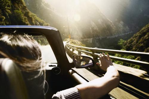 A mountainside road trip in a convertible