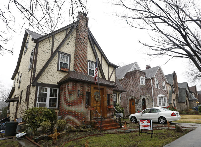 FILE - This  Jan. 17, 2017 file photo shows the boyhood home of President Donald Trump  in New York.    The 1940 Tudor-style house in Queens is on Airbnb and is being offered for $725 a night.  (AP Photo/Kathy Willens)