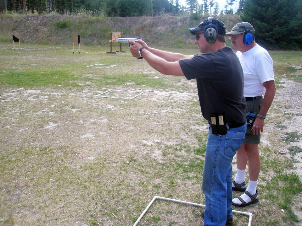 FILE - In this Aug. 5, 2009, file photo Gary Marbut, right, works with Brad Stemple, left, on a shooting range in Missoula, Mont. After Montana passed a 2009 law crafted by Marbut declaring that federal firearms regulations don't apply to guns made and kept in that state, eight other states enacted similar laws. Marbut, a gun activist, said he drafted the measure as a foundation for a legal challenge to the federal power to regulate interstate commerce under the U.S. Constitution. (AP Photo/Matt Gouras)