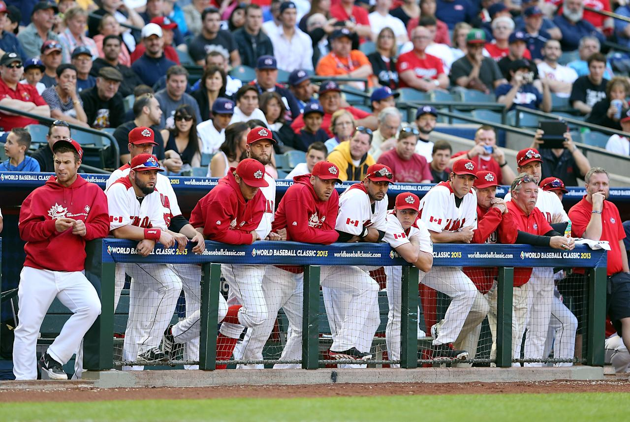 PHOENIX, AZ - MARCH 10:  Players from Canada react on the bench during the ninth inning of the World Baseball Classic First Round Group D game against USA at Chase Field on March 10, 2013 in Phoenix, Arizona. USA defeated Canada 9-4. (Photo by Christian Petersen/Getty Images)