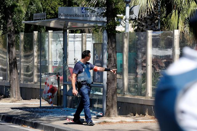 <p>A French policeman walks near one of two bus shelters after one person was killed and another injured after a vehicle crashed into bus shelters in Marseille, France, Aug. 21, 2017. (Photo: Philippe Laurenson/Reuters) </p>
