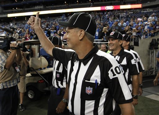 Line judge Ron Marinucci gives a thumbs up while walking on the field before the Minnesota Vikings-Detroit Lions NFL football game in Detroit Sunday, Sept. 30, 2012. (AP Photo/Paul Sancya)