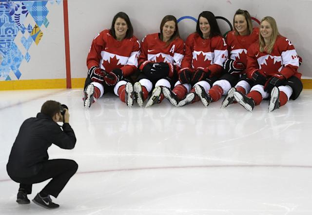 Canada's women's ice hockey team players Gillian Apps, from left, Jayna Hefford, Catherine Ward, Marie-Philip Poulin and Haley Irwin pose for a photograph during a training session ahead of the 2014 Winter Olympics, Thursday, Feb. 6, 2014, in Sochi, Russia. (AP Photo/Julio Cortez)