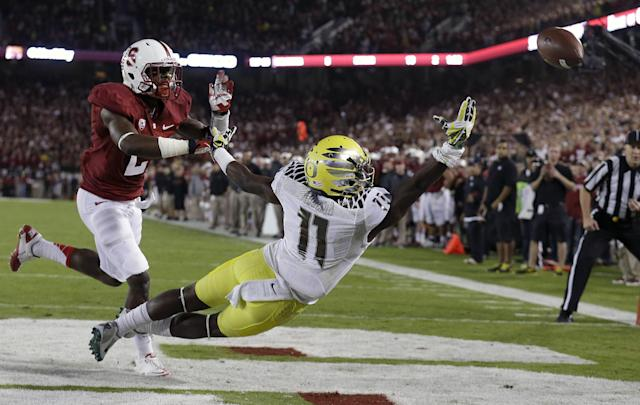 Oregon wide receiver Bralon Addison (11) cannot catch a fourth-down pass from quarterback Marcus Mariota as he is covered by Stanford cornerback Wayne Lyons (2) during the first quarter of an NCAA college football game in Stanford, Calif., Thursday, Nov. 7, 2013. (AP Photo/Jeff Chiu)