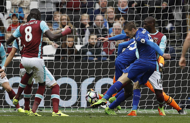 <p>Leicester's Jamie Vardy scores his side's third goal during the English Premier League soccer match between West Ham and Leicester City at London Stadium in London, Saturday, March 18, 2017. (AP Photo/Frank Augstein) </p>